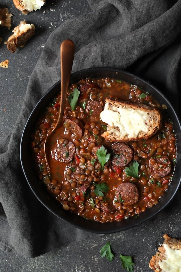 Soupy Spanish Lentils with Chorizo and Manchego Toast overhead closeup
