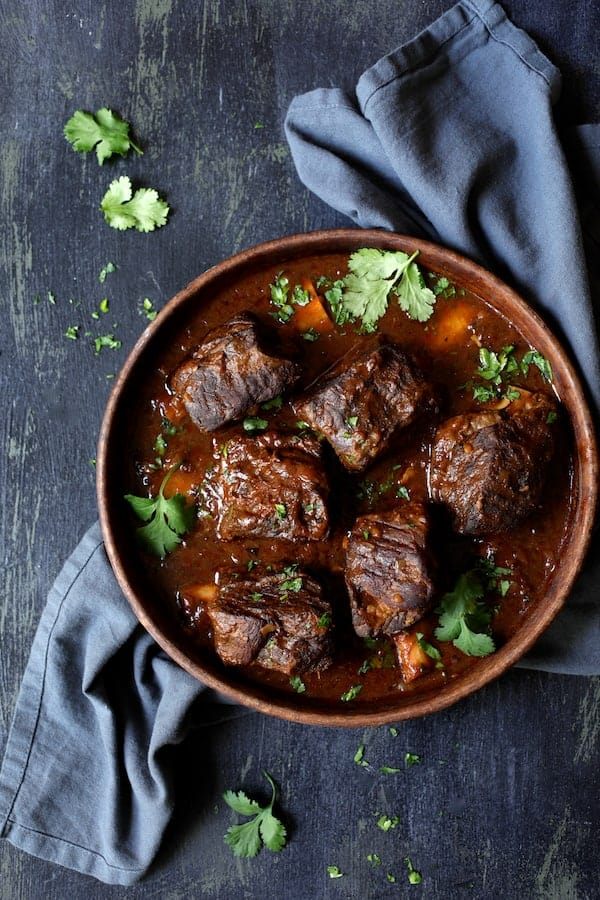 Slow Cooker Beef Short Ribs Barbacoa with Cilantro Lime Cauliflower Rice - Overhead shot on blue background with blue napkin