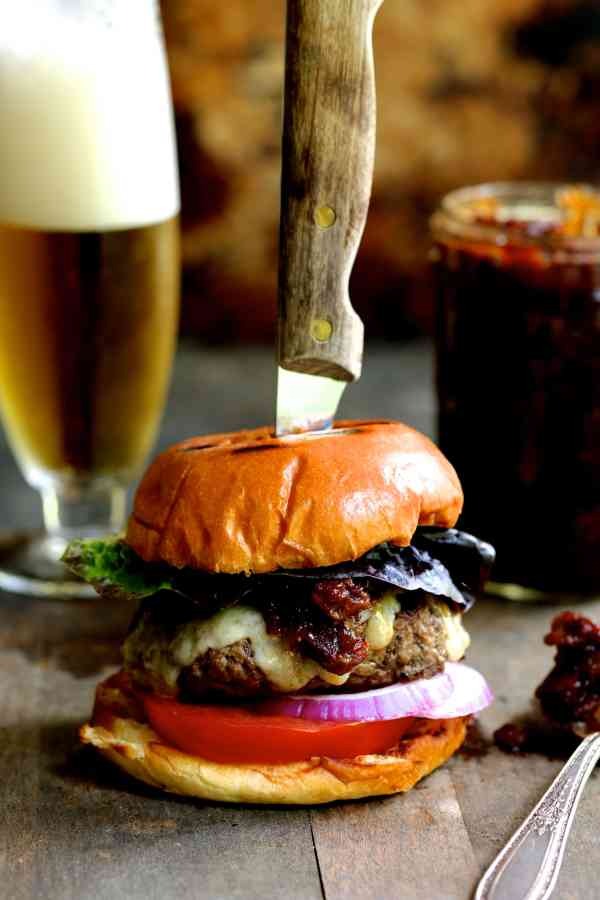 Grilled Burgers with Bacon Tomato Jam and Smoked Gouda + The Fresh Market's Father's Day Meal - Another shot of burger and jam with foamy beer in the background