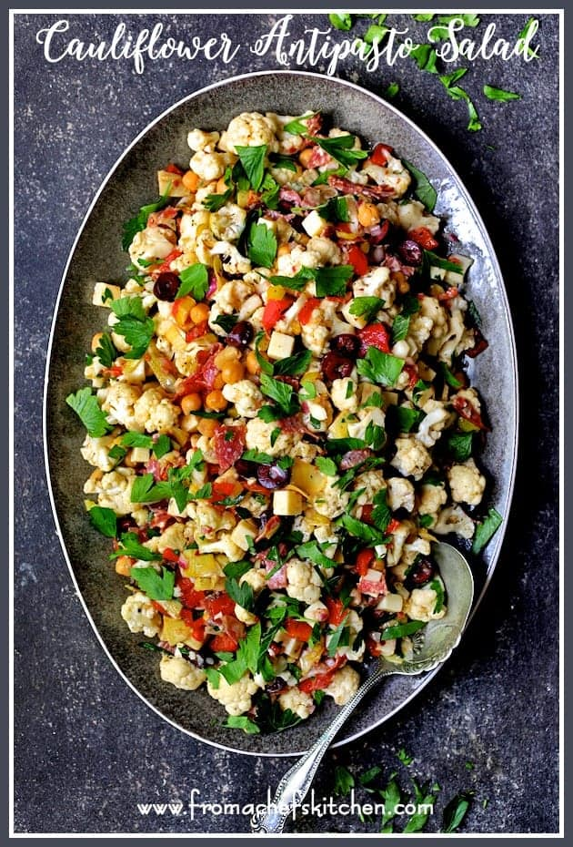 Cauliflower Antipasto Salad is easy summertime fare that's light, crunchy, crazy flavorful and perfect for feeding a crowd! #cauliflower #antipasto #salad #Italian #Italianfood