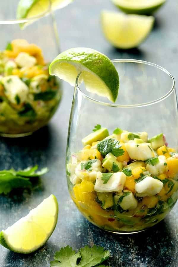 Halibut Ceviche with Mango and Avocado close-up shot in glass