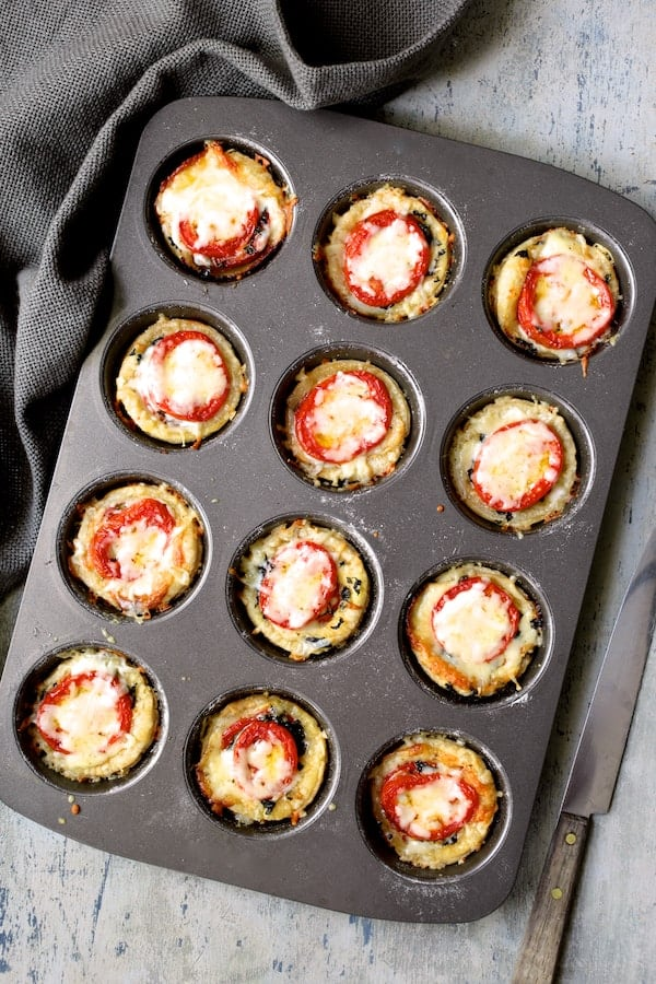 Mini Southern Tomato Pies - Overhead shot of freshly baked mini pies still in muffin pan