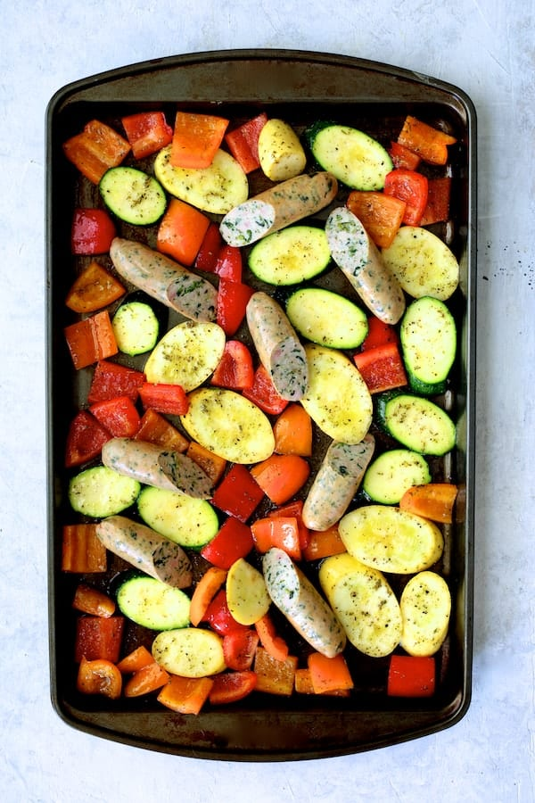 Mediterranean Sheet Pan Chicken Sausage and Vegetables with Garlic Parmesan Polenta with cut vegetables and sausage added