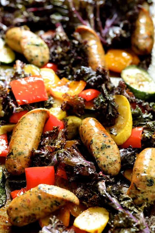 Mediterranean Sheet Pan Chicken Sausage and Vegetables with Garlic Parmesan Polenta - Closeup of roasted vegetables and sausage on sheet pan