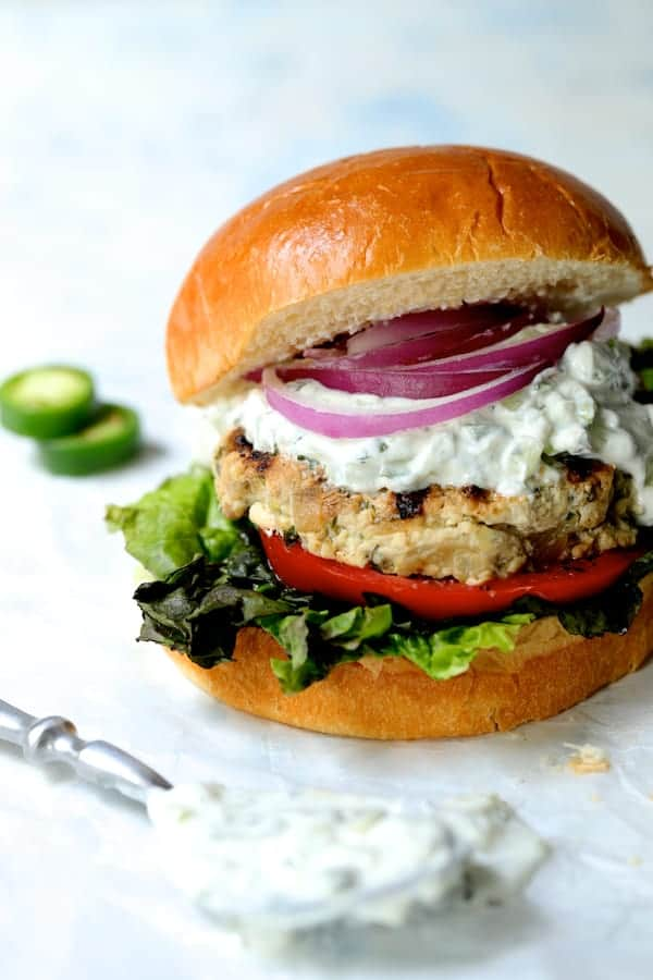 Chicken Zucchini Feta Burgers with Jalapeño Tzatziki - Close-up shot with crumb of buns exposed
