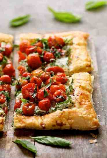 Herbed Ricotta and Burst Cherry Tomato Tart - Close-up shot of tart looking straight on