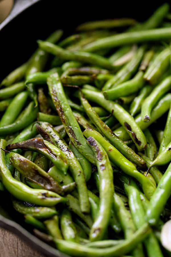 Skillet Charred Green Beans with Goat Cheese Chipotle Butter - Close-up of charred beans in cast iron skillet