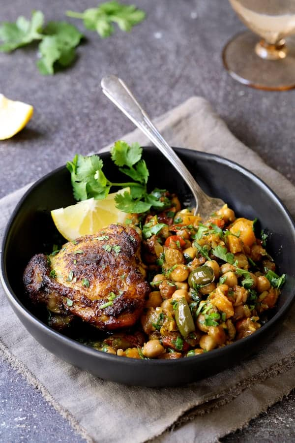 Moroccan Chicken Tagine with Butternut Squash Chickpeas and Olives - Single serving in black bowl