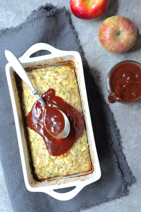 Turkey Apple Meat Loaf with Balsamic Ketchup Glaze - Overhead shot of meat loaf with glaze being spread on the top with a spoon