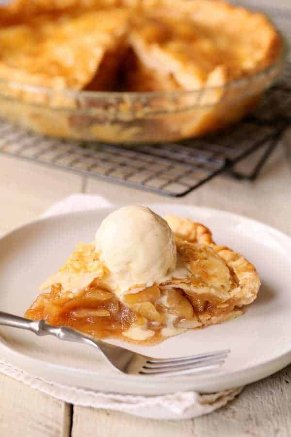 How to Speed Bake an Apple Pie - Slice of pie on white plate with vanilla ice cream
