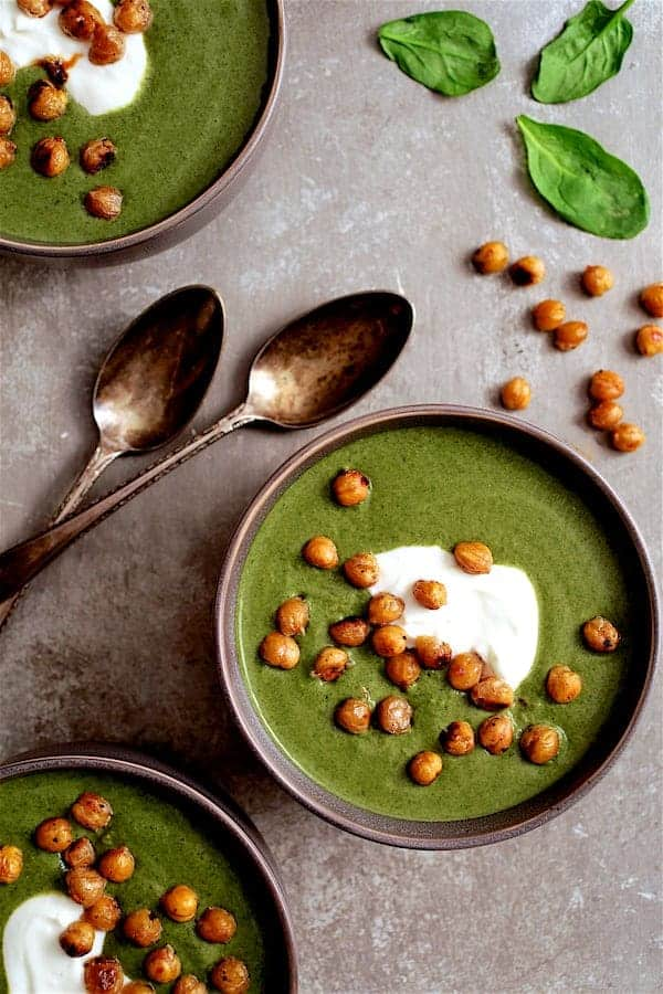 Spinach and Goat Cheese Bisque with Crispy Lemon Chickpeas - Overhead close-up shot of bisque on gray background