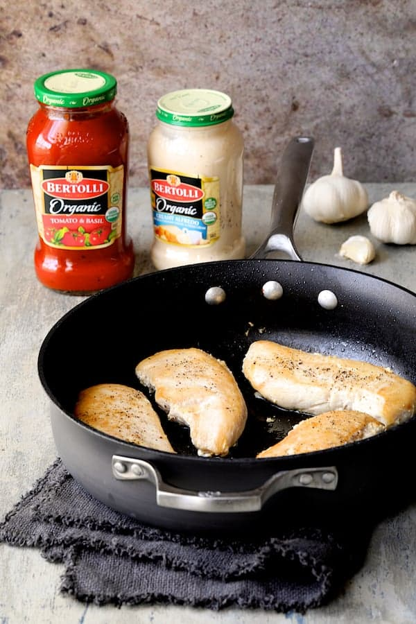 Chicken in Rosa Sauce with Roasted Red Bell Pepper and Spinach - Photo of chicken in skillet after browning