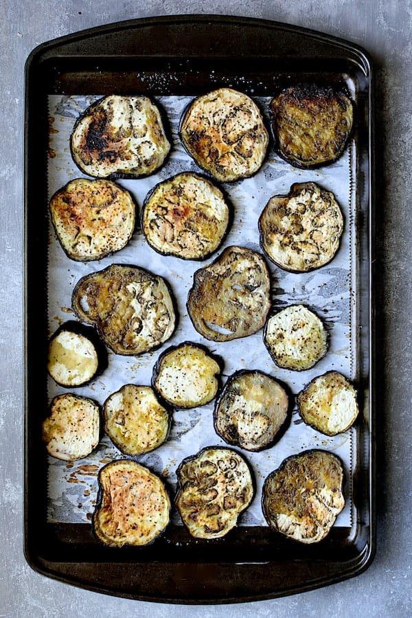 Turkish Eggplant Casserole - Imam Bayildi - Baked eggplant on parchment paper on baking sheet