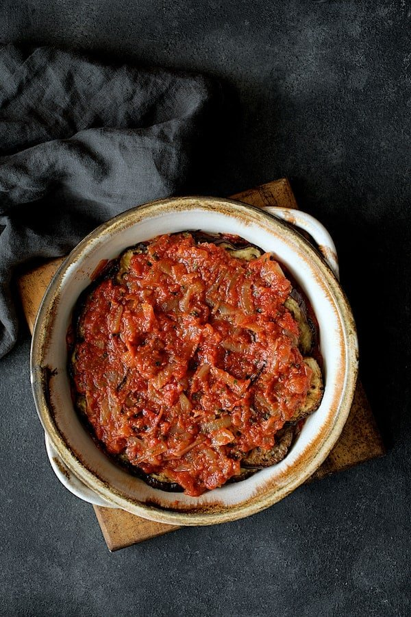 Turkish Eggplant Casserole - Imam Bayildi - Overhead shot of final later of tomato sauce in baking dish