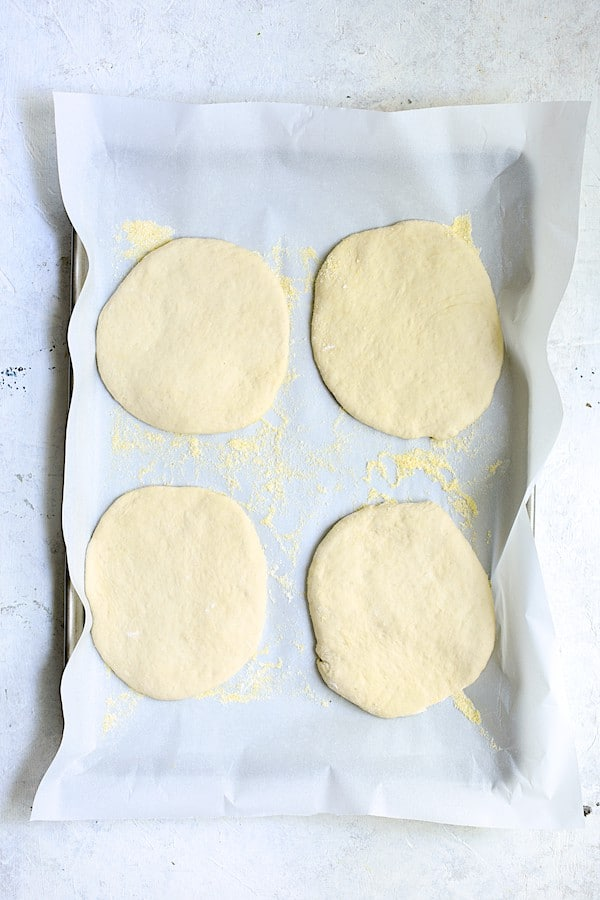 Overhead shot of focaccia dough divided into four individual circles