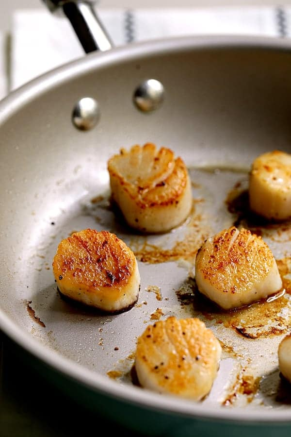 Sweet Corn Risotto with Seared Sea Scallops and Basil Salsa Verde - Seared scallops in cookware