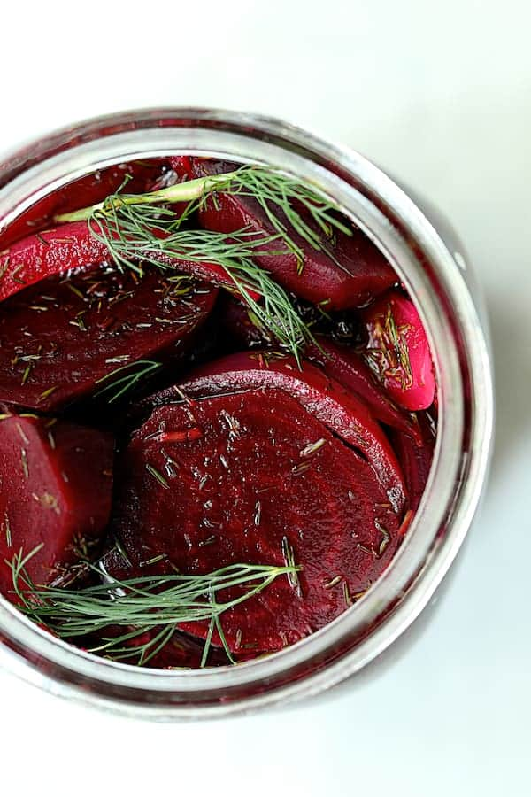 Quick Pickled Beets with Dill - Overhead close-up shot looking into glass jar