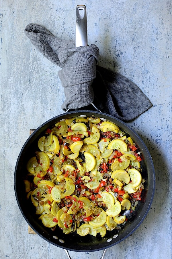 Black Bean and Yellow Squash Enchilada Casserole - Overhead shot of sauteed yellow squash in skillet