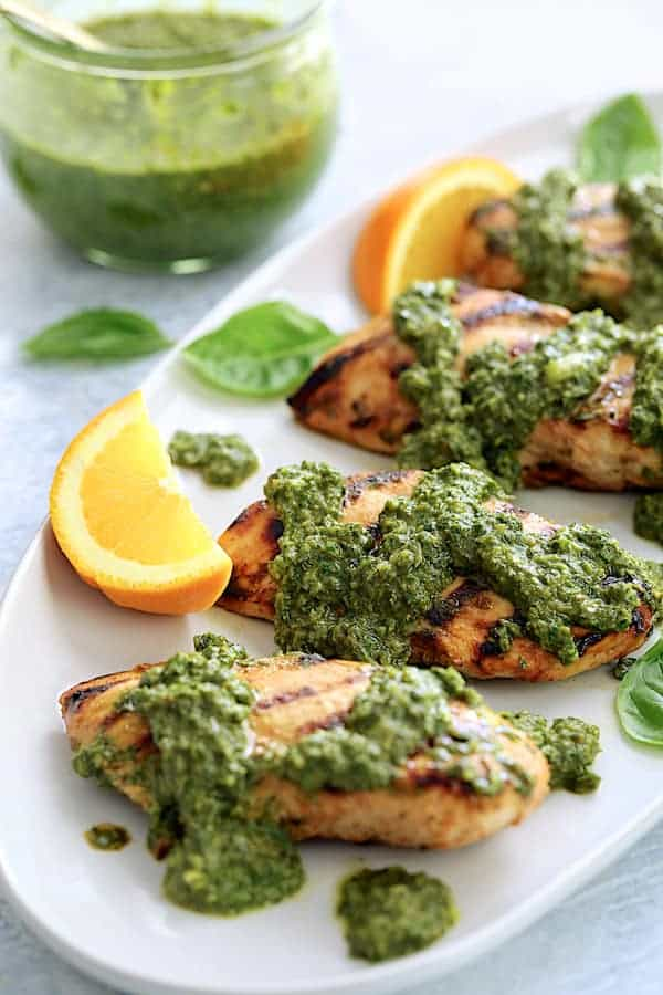 Grilled Citrus Chicken with Spicy Basil Chimichurri Sauce - Straight-on shot of dish on white serving platter