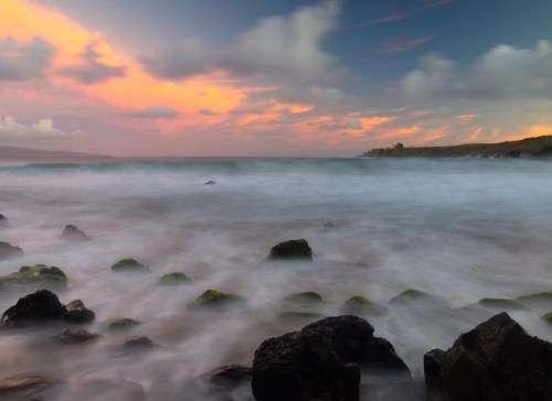 Waves roll into the Honolua beach during a beautiful sunrise. Maui, Hawaii