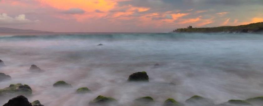 Waves roll into the Honolua beach during a beautiful sunrise. Maui, Hawaii