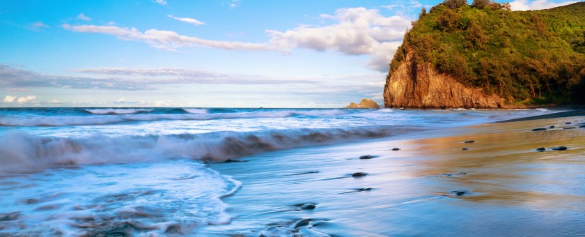 A beautiful scenic photograph of the back sand beach of Pololu Valley