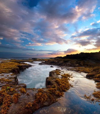 Photograph of a beautiful sunset along the Big Island coastline.