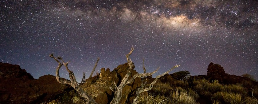 Milky way photograph over the rugged landscape of Mauna Kea