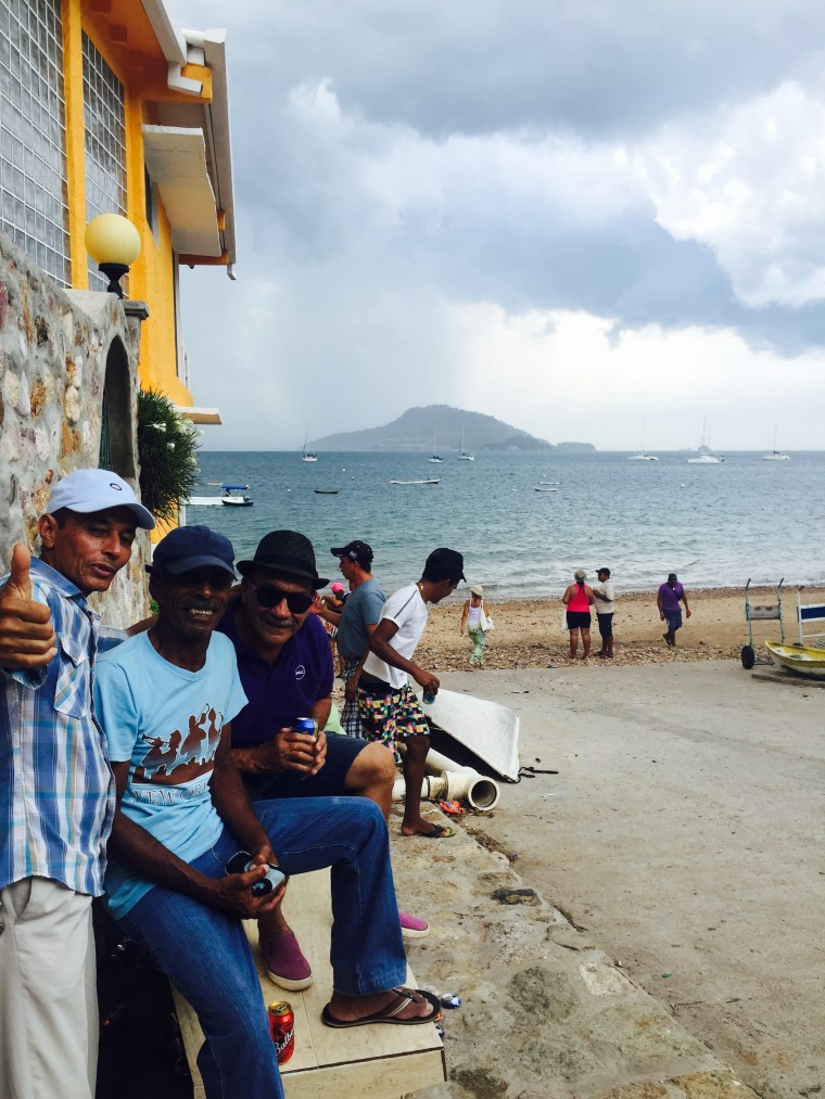 Locals celebrating Saint Carmens Day on the beach, rain or shine!