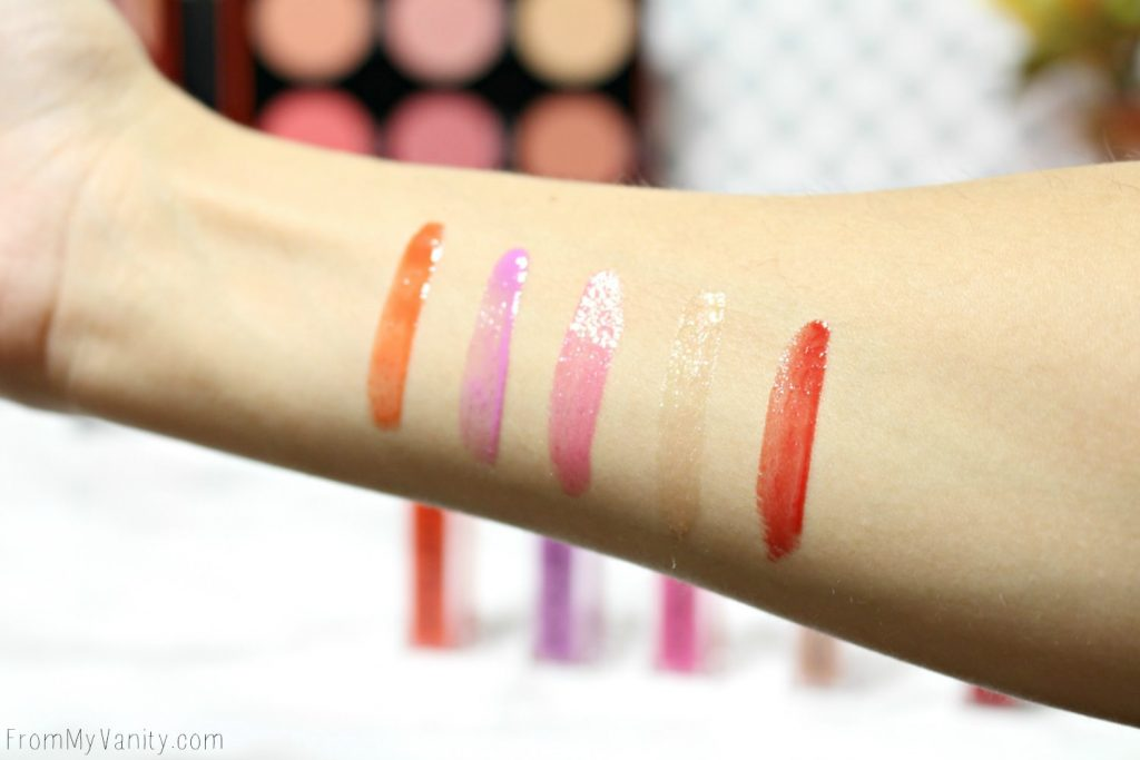 Arm swatches of the Smashbox Light It Up: Gloss To Go Set