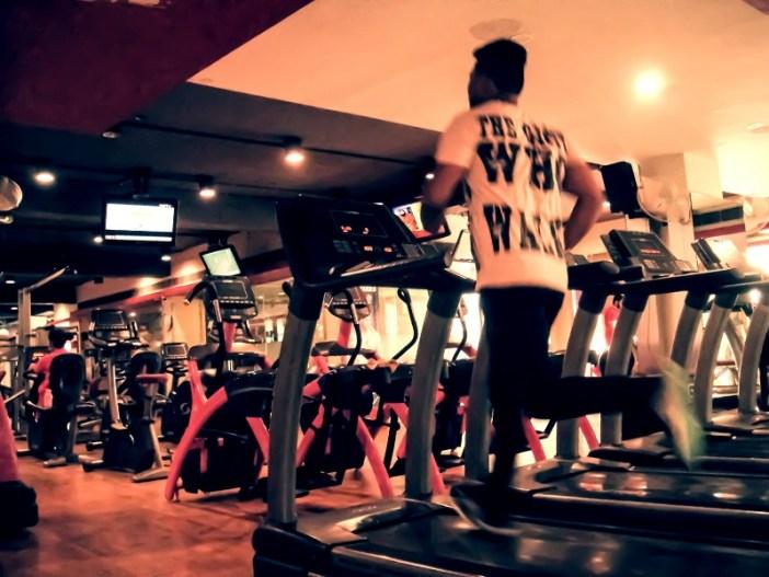 A guy running on treadmill