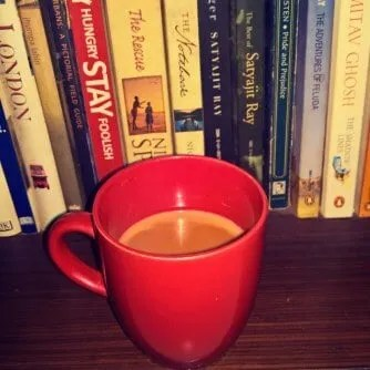 Adarak Tea in a cup and lots of books