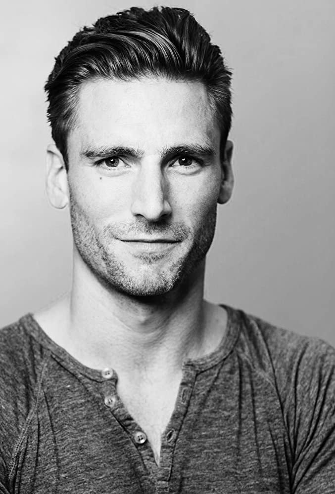 A headshot of actor Andrew Walker
