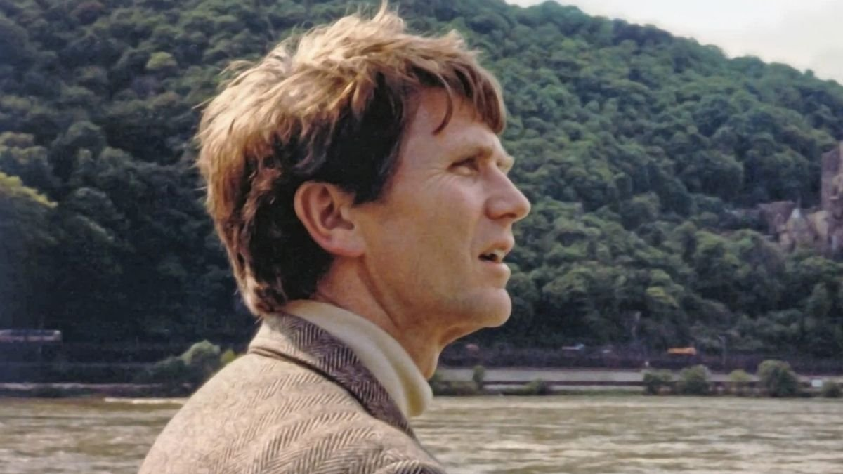 The book cover of Eugene England's biography showing him in a turtleneck and suit jacket by a lake