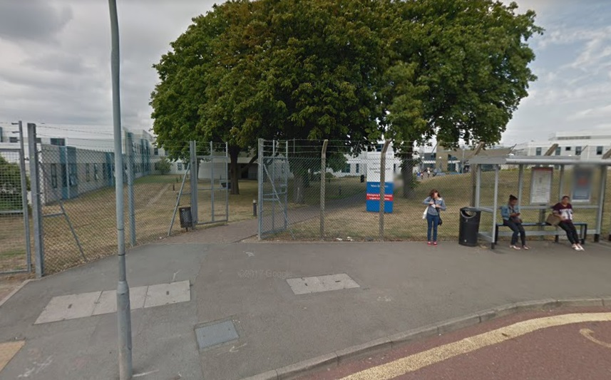 The six-foot barbed wire fencing of Queen Elizabeth Hospital, Woolwich