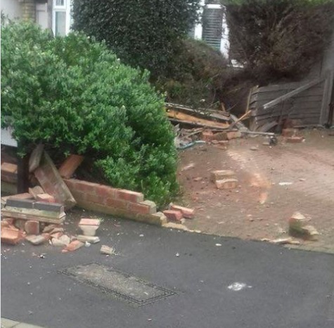Man arrested after car smashes into garden