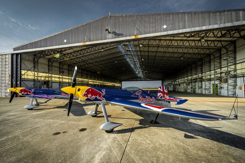 Paul Bonhomme's and Steve Jones's airplanes are seen in front of a hangar before Red Bull Barnstorming photoshooting in Llandbedr, Wales, UK, on April the 08th, 2015