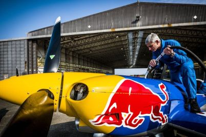 Paul Bonhomme refills his airplane before flying through a hangar during Red Bull Barnstorming photoshooting in Llandbedr, Wales, UK, on April the 09th, 2015