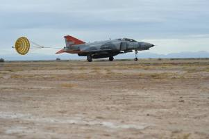 A QF-4 Phantom lands on the runway during the Phinal Phlight event, Dec. 21, 2016 at Holloman Air Force Base, N.M. To date, the QF-4 Phantom has flown approximately 145 unmanned sorties. (U.S. Air Force photo by Staff Sgt. Eboni Prince)