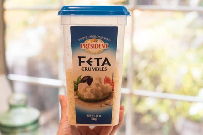 A large container of President Feta Crumbles purchased at Costco.