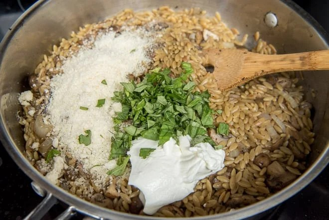 Sour cream, Parmesan and chopped fresh basil are added to the saute pan.