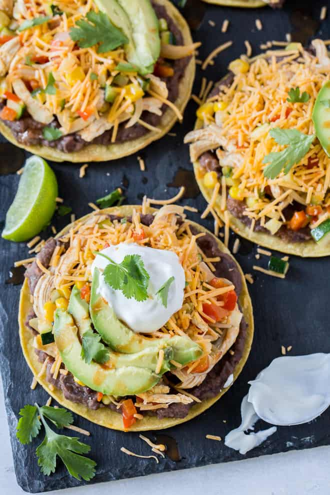 Chicken and Veggie Baked Tostadas on a black slate board shot from over the top.