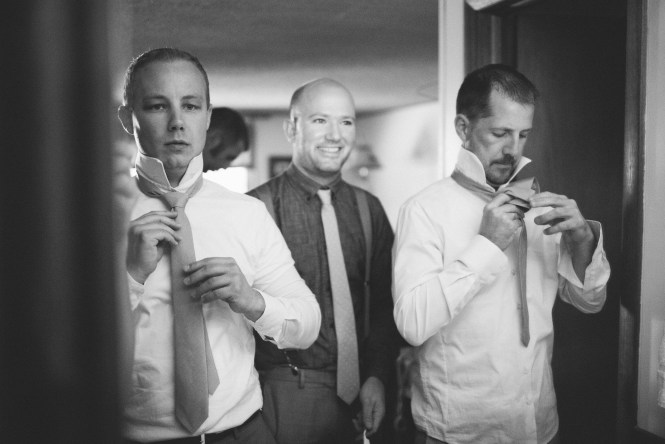 Grooms Party Prep tying ties Saratoga Inn Wyoming