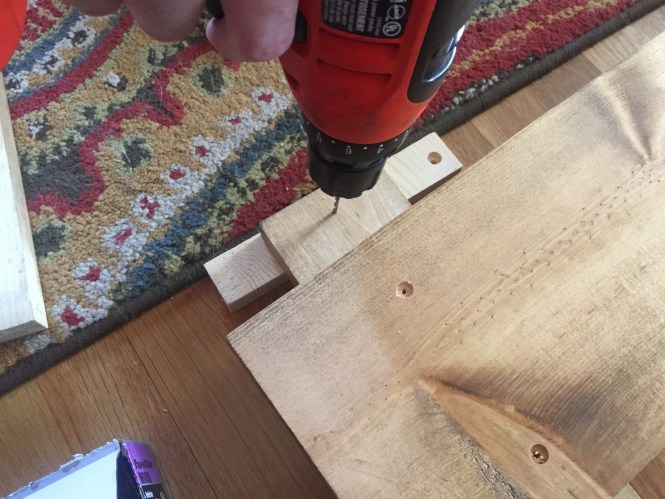 Measure each side to line up vertical headboard legs