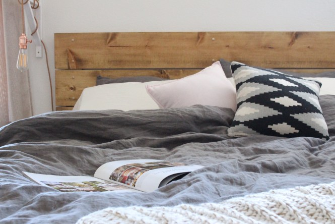 Cozy gray linen bedding, DIY wooden headboard, Rocky Mountain Bride Wyoming