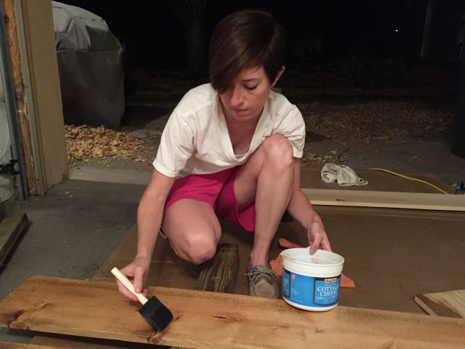 Apply the second coat of stain to pine boards using a foam brush