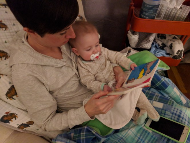 Henry five months reading Dr. Suess book with mom Kelly