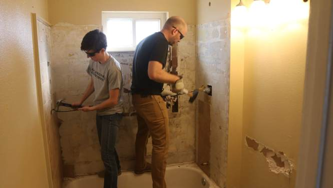 Mini-master bathroom remodel, demoing beige shower tile