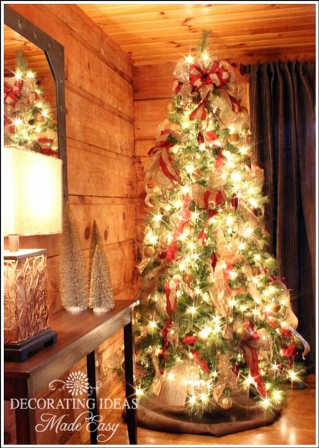 Fanciful Wreath And Lights Over The Rustic Garage Doors Beautiful Log Home Decorated For Christmas