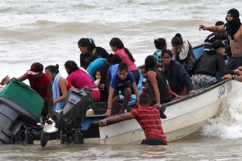 venezolanos Trinidad mar